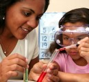 Lab science study with teacher and young student