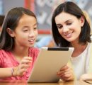 teacher and student with tablet - square